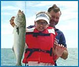 A young lady with her own big bluefish